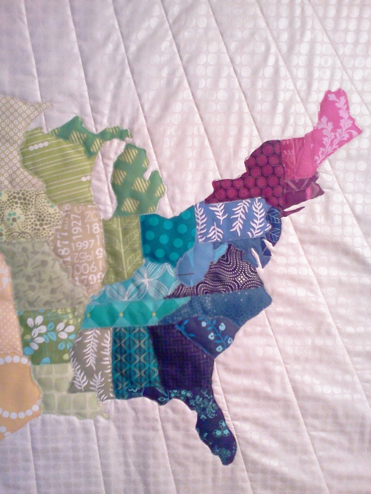 map quilt by Crazy Old Ladies Quilts-- Would work well for a map of Australia with Australian natural flora prints. See a picture of the full quilt here: http://www.pinterest.com/pin/6262886956286194/