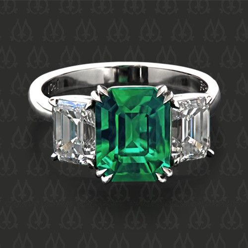 Three-stone ring with an emerald and two emerald cut diamonds by Leon Mege More
