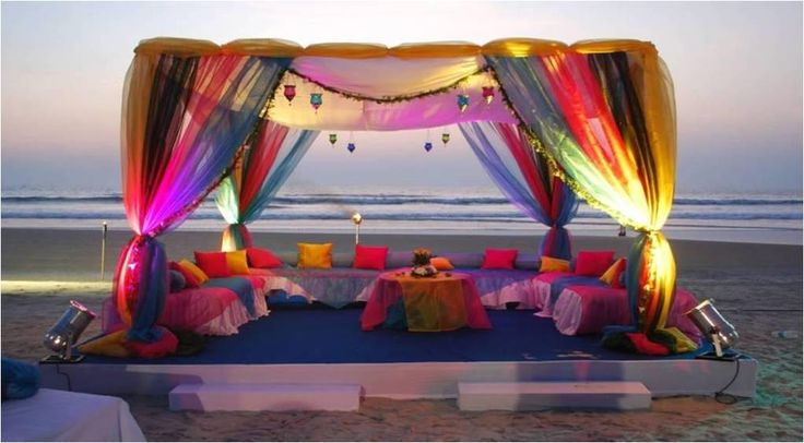 Beach Wedding Inspirations - Multi Colored Drapes For a Beach Mandap, and Seating Arrangement | WedMeGood #wedding #decor #beachwedding #wedmegood #beach