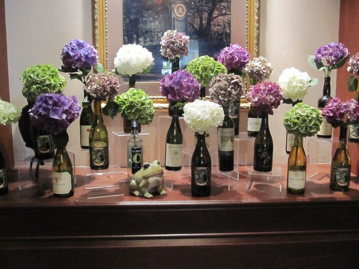 The combination of the beautiful hydrangea and wine bottles made for a perfect entrance display to one of our winery weddings.