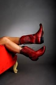 Red Cowboy Boots with....everything!  A MUST!