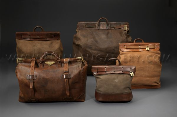 A collection on vintage Louis Vuitton 'Steamer' bags, modelled on 19th Century US Mailbags, also featured, a Louis Vuitton 'Square Mouth' Gladstone bag.