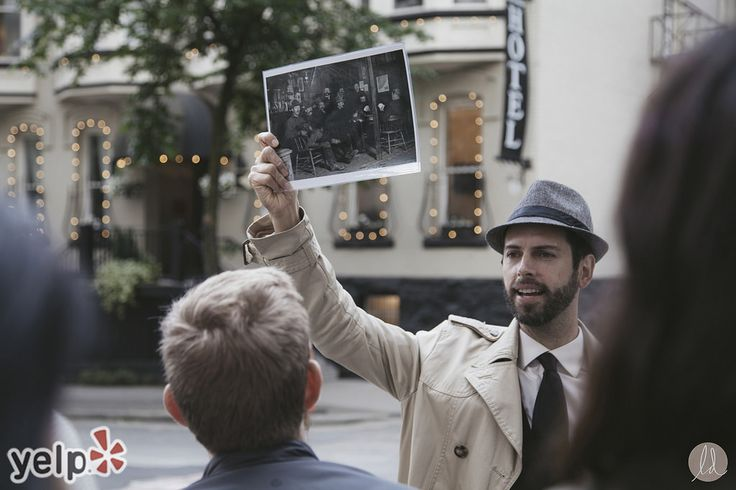 Forbidden Vancouver founder and chief storyteller Will Woods shows off archival photos to Prohibition City tour guests. (Photo by Lindsay Elliot of LindsaysDiet.com for Yelp)
