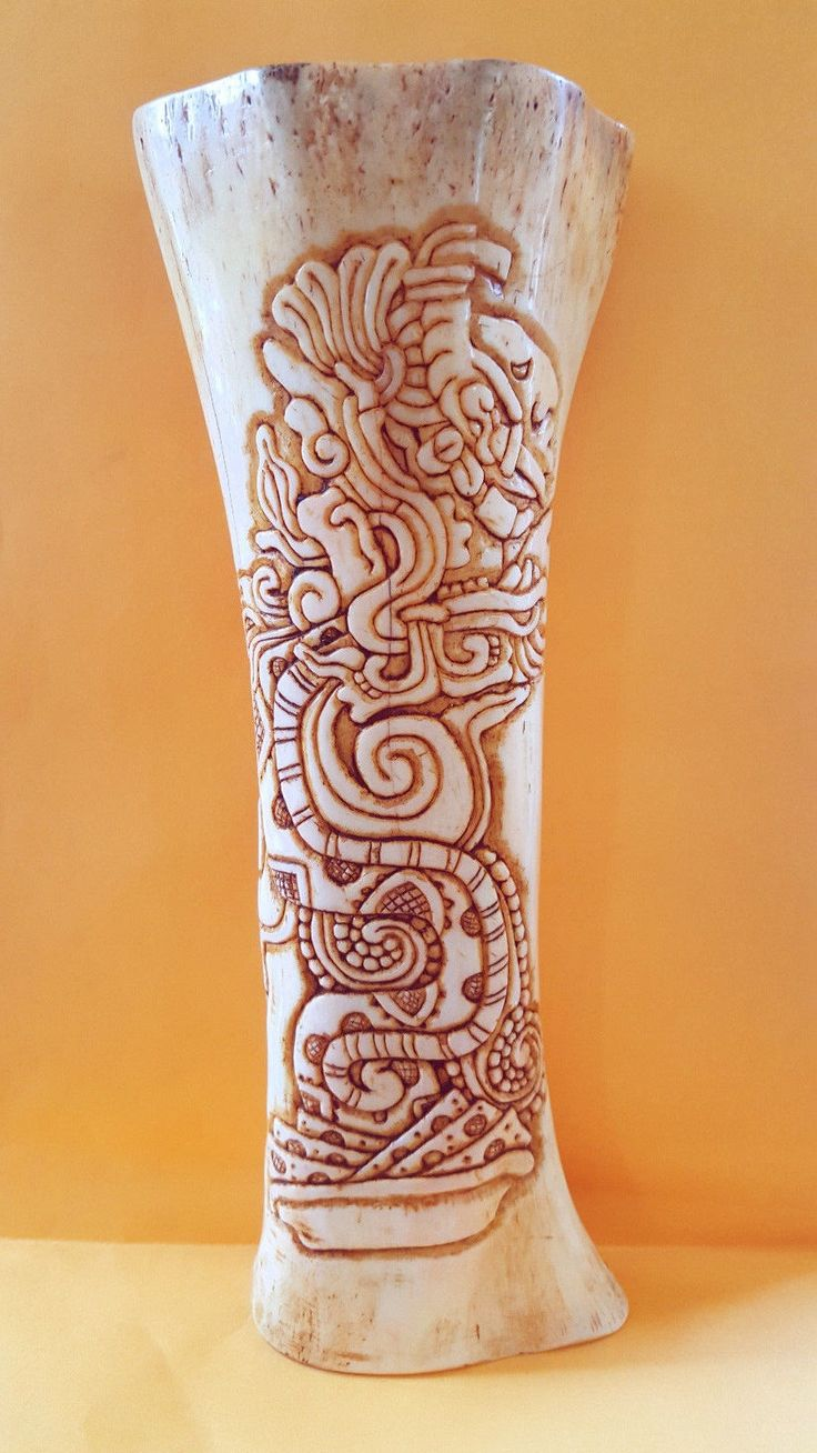 "Handmade Carving ""Mayan Vision"" on Tube Bull's Bone by Itzae   Copan Ruinas Honduras    9.5""hight x 3.5""wide    Amazing Hand made carving on authentic Bull' bone made by ITZAE one of the few Mayan artists remaining on Copan who is still doing Carvings on Bones and Stones from his ancestors Mayan civilization  This is very accurate representation of the ""MAYAN VISION "", totally made by hand , only using a rudimentary Knife as you can see on the video below ,it take couple of months of…"