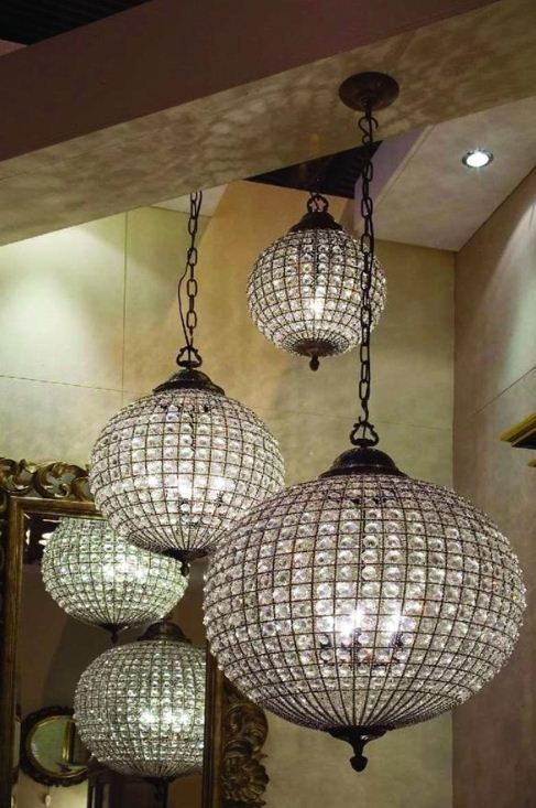 Crystal ball chandeliers!!  Gasp.  Classic, brilliant orbital light, crystal prisms galore.  Love them. :)