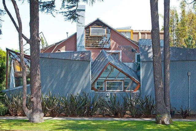 Gehry's first significant brush with fame came with the 1978 construction of a Santa Monica residence he designed for himself and his family. The project wrapped an existing bungalow in angular volumes clad in a riot of everyday suburban materials like plywood and chain link. As opinionated as it was sculptural, the house earned both cheers and jeers in short order. In 2012 it won the American Institute of Architects' prestigious Twenty-Five Year Award.
