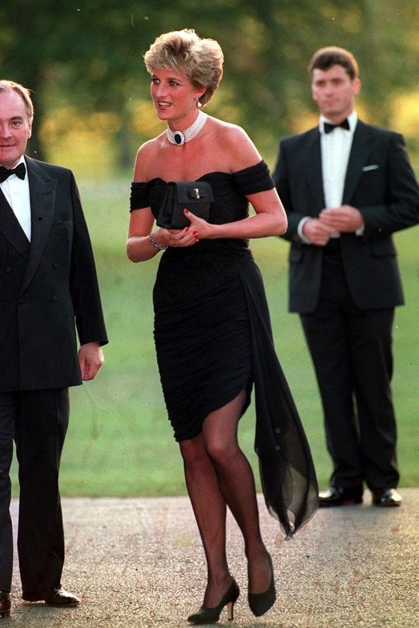 JUNE 1994 - On the night that the programme about Prince Charles' relationship with Camilla Parker Bowles aired, Diana stole the next day's headlines by arriving for a gala dinner at the Serpentine Gallery in London's Hyde Park in a black off-the-shoulder Christina Stambolian dress with a pearl choker.