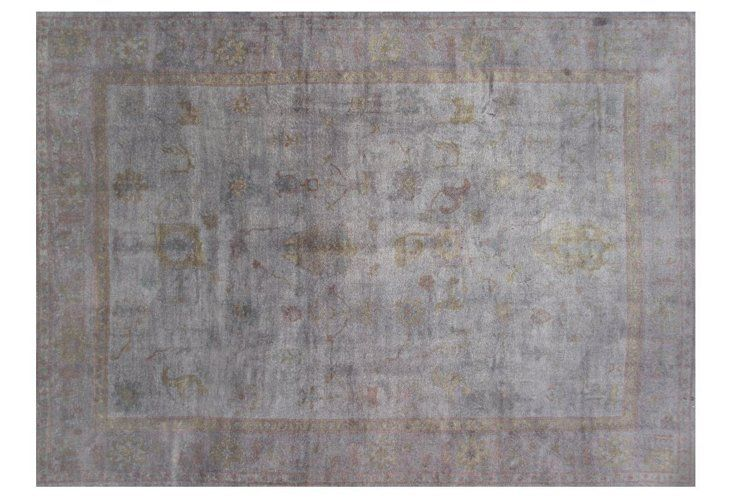 Overdyed in a warm gray, this Turkish carpet is timeless and chic.