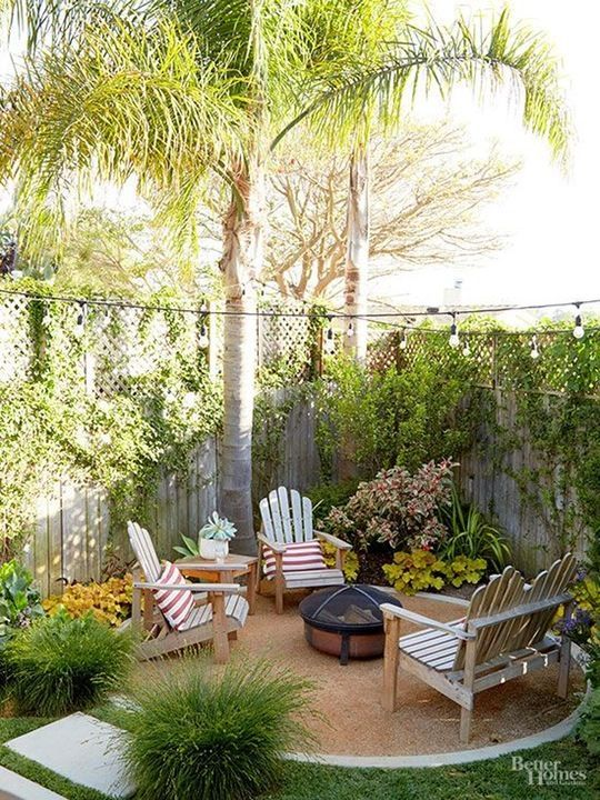 Small backyard ideas - round gravel patio with firepit and comfy seating.