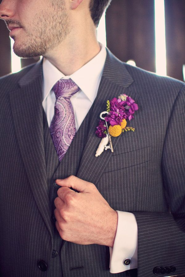 Key in Bout. cool idea. have one in bride's bouquet too?