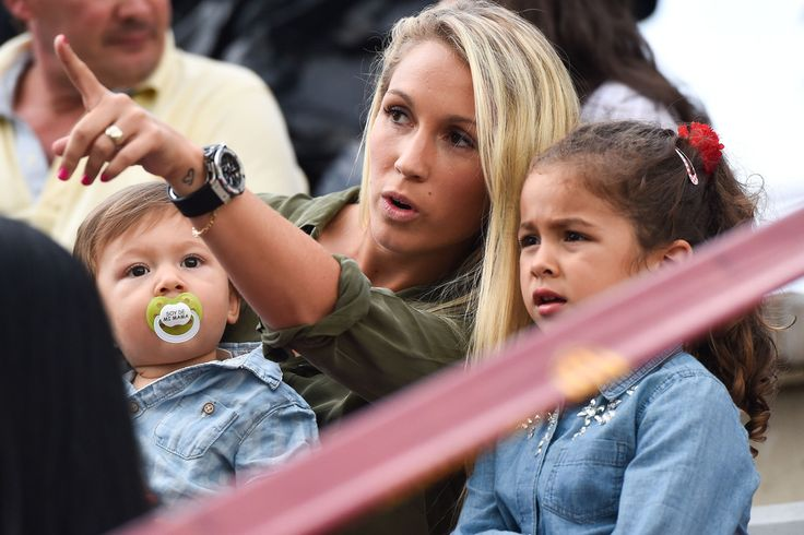 Luis Suarez's wife Sofia Balbi holds her son Benjamin Suarez as she talks with her daughter Delfina Suarez during a friendly match between FC Barcelona B and Indonesia U19 at Ciutat Esportiva on September 24, 2014 in Barcelona, Catalonia.
