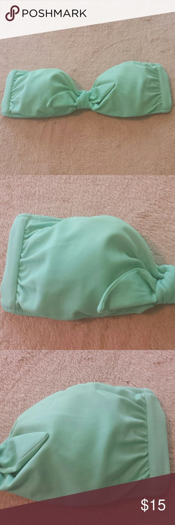 Victoria's Secret Bandeau Bikini Top. Sz. Med. Sea foam/ seafoam / mint green bandeau bikini top by Victoria's Secret. No holes or stains. Good used condition. Zoom in on all pics to see condition for yourself. It is lightly padded, no underwire, size Small. Straps are not included. Victoria's Secret Swim Bikinis