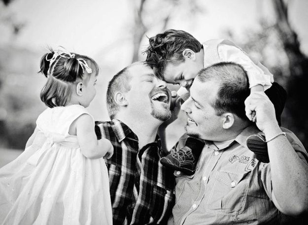 """Trent and Troy with their kids.""""Troy and I have been together for 16 years. We both wanted children,"""" says Trent. """"In 2010 we were blessed with two beautiful kids, Inara and Tydan. In this photo, we were at my sister's property on a family holiday and were fortunate enough to get this lovely photo, and other amazing shots, during a family photo shoot. This photo represents the immense happiness we share together."""""""