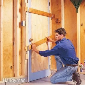"""Safe Home Security Tips-reinforce center panel of door with 1/2"""" plywood, and add 2 bar holders high and low with 2x4s"""