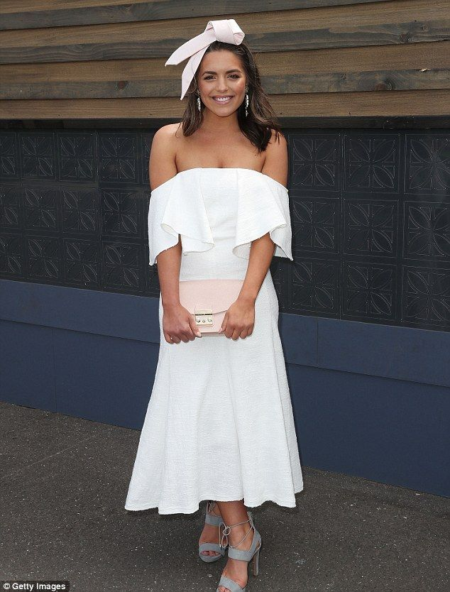 The Neighbours would approve! Soap star Olympia Valance, 28, highlighted her curves in a lady-like white frock and offered just a glimpse of skin as she arrived at Melbourne's Stakes Day 2016 on Saturday