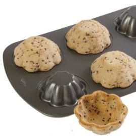 """Cookie Bowls - the accompanying text says, """"Lifehacker also has a trick for making EDIBLE DISHES... Mold cookie dough over the BOTTOM of muffin tin... perfect for filling with a scoop of ice cream, pudding or fruit."""