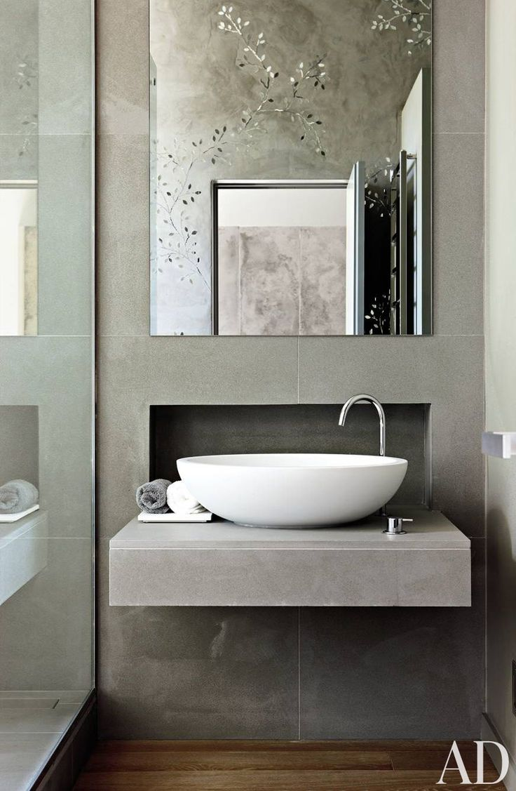 Glass mosaics, seen in the mirror, decorate the master bath in a contemporary London residence.: Bathroom Design, Concrete Bathroom, Idea, Bathroom Sink Bowl, Contemporary Bathrooms, Modern Bathroom Sink, Bathroom Basin, Grey Bathroom, Powder Rooms
