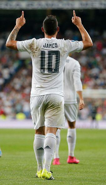 James Rodriguez of Real Madrid celebrates after scoring during the La Liga match between Real Madrid CF and Real Betis Balompie at Estadio Santiago...
