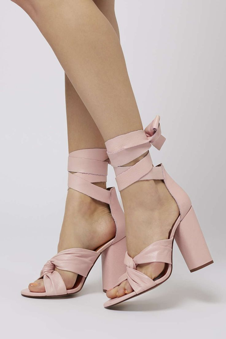 Take heels to the next level with these heeled sandals. We love the front knot, chunky heel and ankle tie detail. A simple way to add instant glam to your party look. #Topshop
