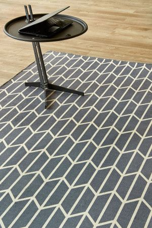 Geo Chevron Grey: 1.5 X 2.3 metres. Printed nylon. Please note that, as these printed rugs are mad...