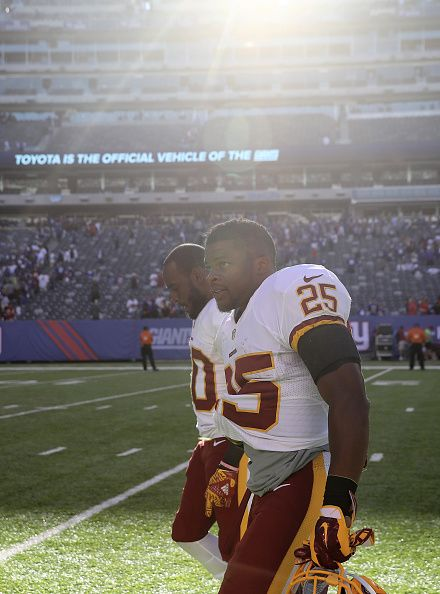 Jamison Crowder and Chris Thompson of the Washington Redskins walk off the field after the game against the New York Giants at MetLife Stadium on...