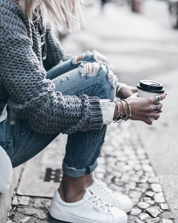 sneakers, distressed denim, sweater, coffee, jewelry details
