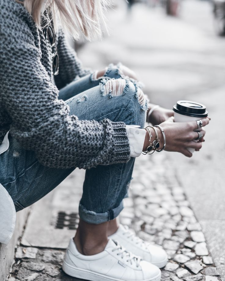 sneakers, distressed denim, sweater, coffee, jewelry details