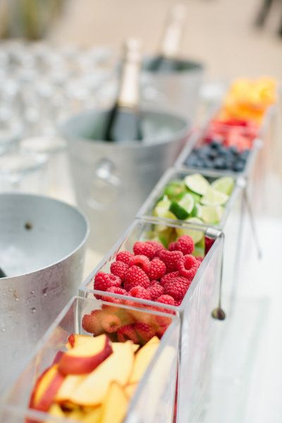 Raspberries, peaches, limes, and other fruit garnish for the mimosa bar. Cute idea! #drinkstation