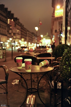 Starbucks Coffee in Paris...at an outdoor cafe...at night...surrounded by city lights! --
