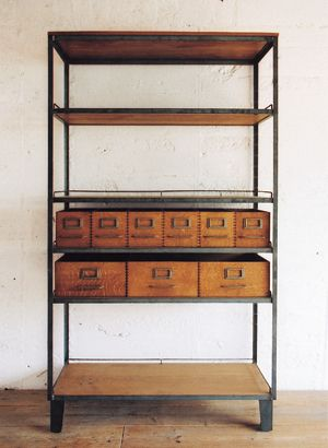 love this rustic/vintage style shelf unit. With the addition of the drawers, you could find a use for this piece of furniture in almost any room.