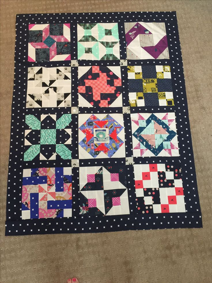 Boy baby quilt with Cotton and Steele sampler.