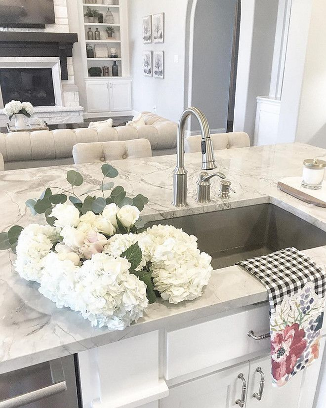 Kitchen stainless sink. Beautiful kitchen island with quartzite countertop and…