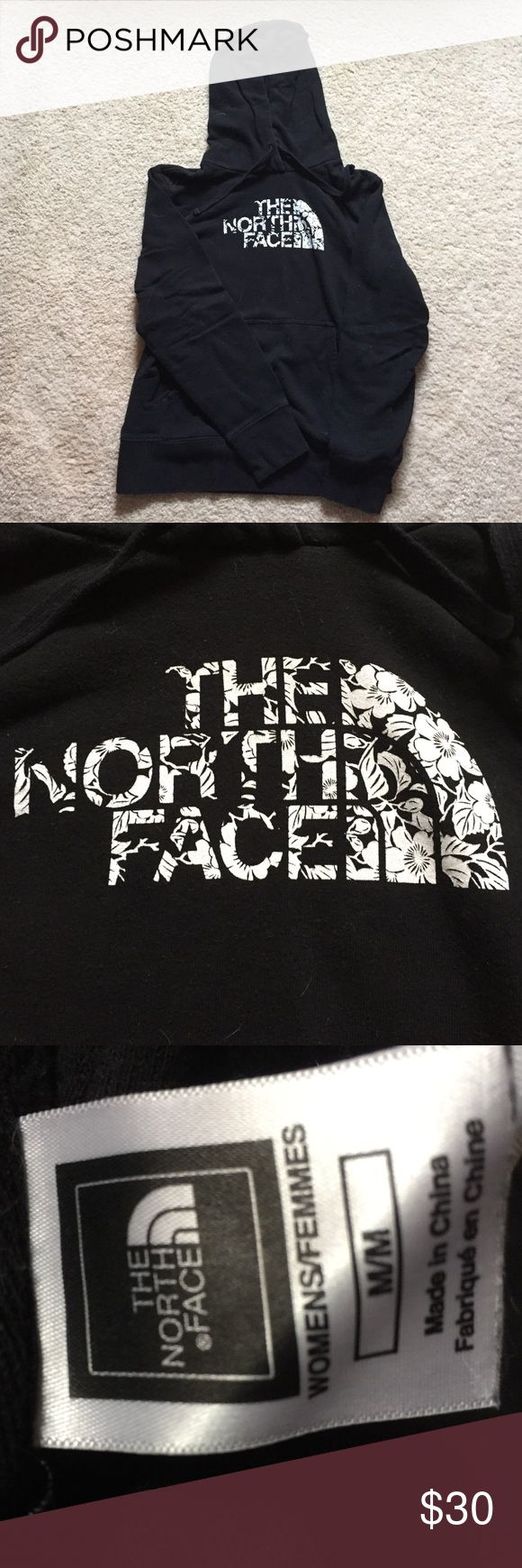 The North Face black and white pullover hoodie Hardly worn at all. Logo is made up of flowers. The North Face Tops Sweatshirts & Hoodies