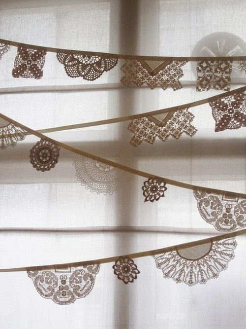 Or this! We could buy paper doilies and fold them over ribbon, then glue them!