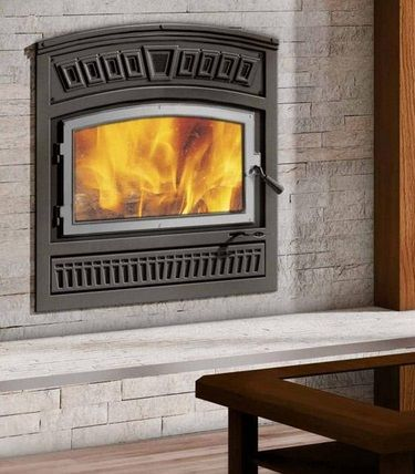 Beautiful, zero clearance wood burning fireplace, perfect for a family room.