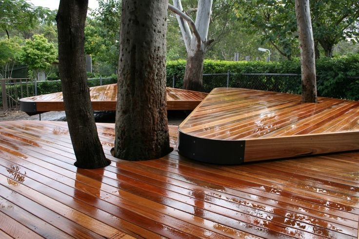 Deck Builders Gold Coast. Spotted gum decking built around the existing tree. Phone Deking 1800DEKING for a free site visit and quote. #deck #timberdeck