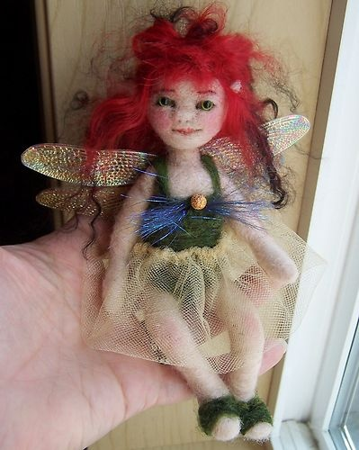a little needle felted fairy doll on ebay, i just finished