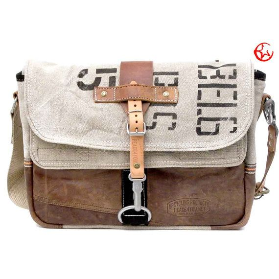 I cannot afford to buy one, but I just love the creativity and aesthetics.   Belgian Military Post Canvas Bag // Handmade & by peace4youBAGS, $299.00