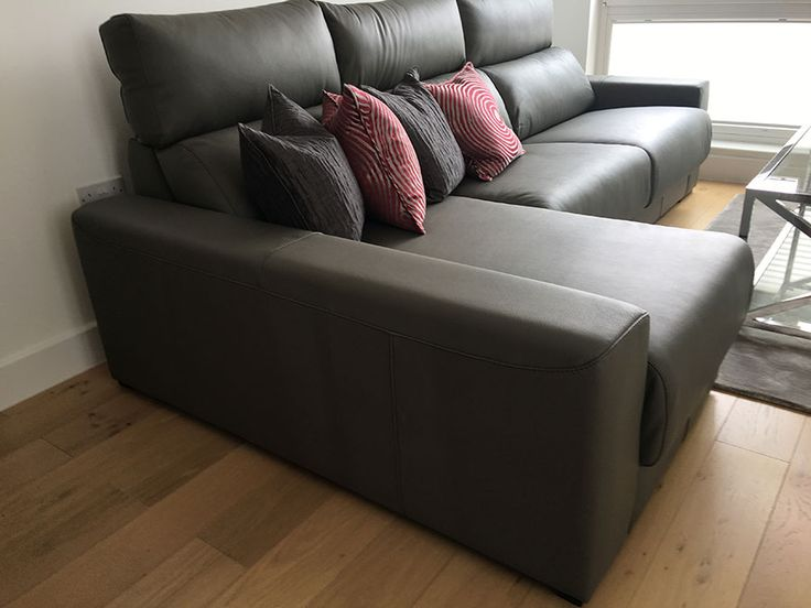 Contemporary leather sofa. Sofa with pull out sliding seats, and under seat storage. Delivered to our client in Brighton.