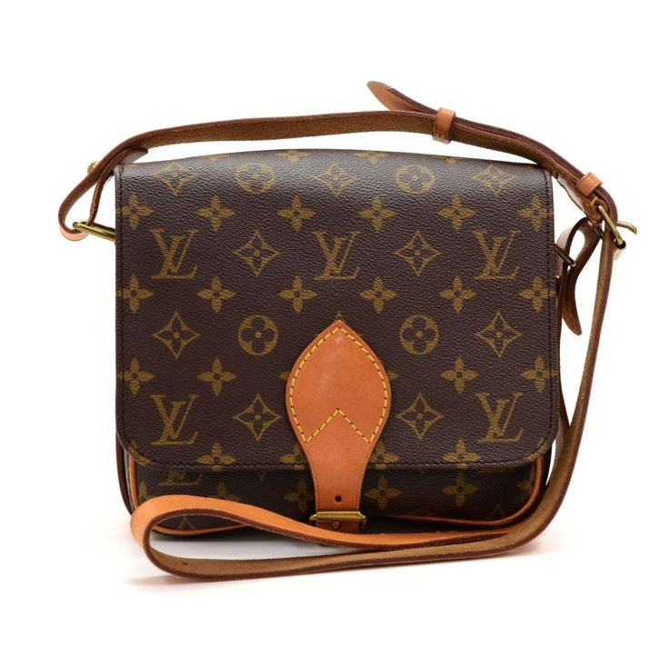 Authentic Louis Vuitton Cartouchiere MM in monogram canvas. Flap top secured with belt closure. Inside is brown washable lining. Comfortably carry on shoulder or across body with cowhide leather strap. #LouisVuitton @fmasarovic