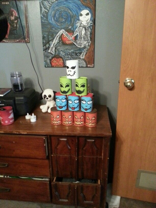 Went to recycling center got some cans painted them to the nightmare before Christmas theme now we got another game ready for Halloween I did bleach them out first though lol
