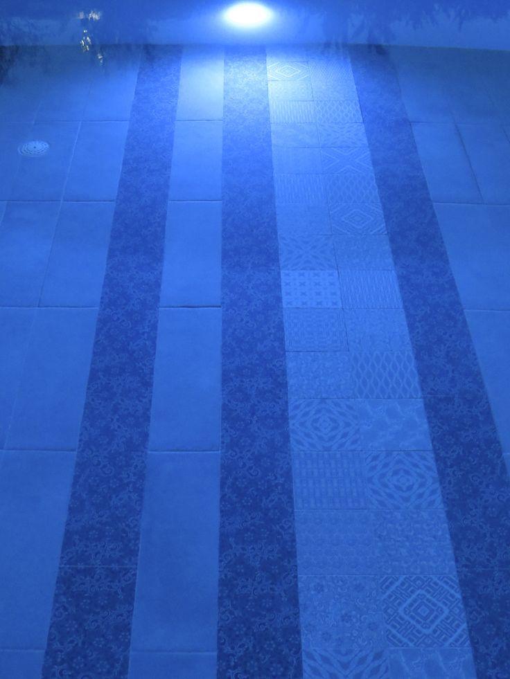 The tiles illuminated at night time