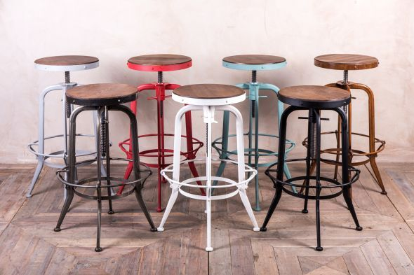 This machinist style, height adjustable bar stool collection comes in a range of seven colours, featuring solid elm seats and welded steel frames...