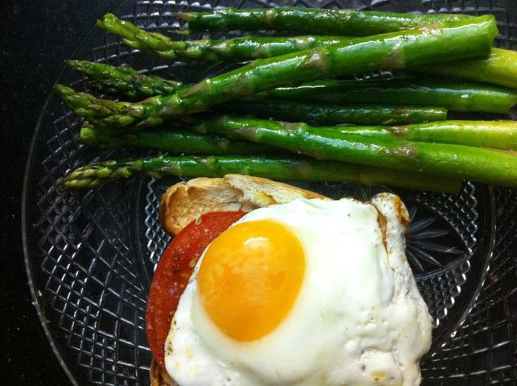 What about this to start your day? Pan seared asparagus with egg and fresh tomato on toast!