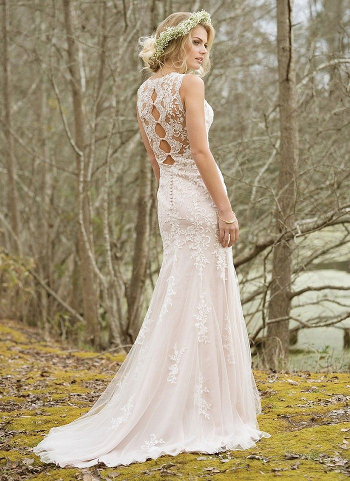 The back details of this high neck, fit and flare tulle and lace gown are something special. Lace appliques cover the illusion neckline and back, continue throughout the bodice, and scatter throughout the skirt to the chapel length train. https://www.lillianwest.com/lillian_west/6464