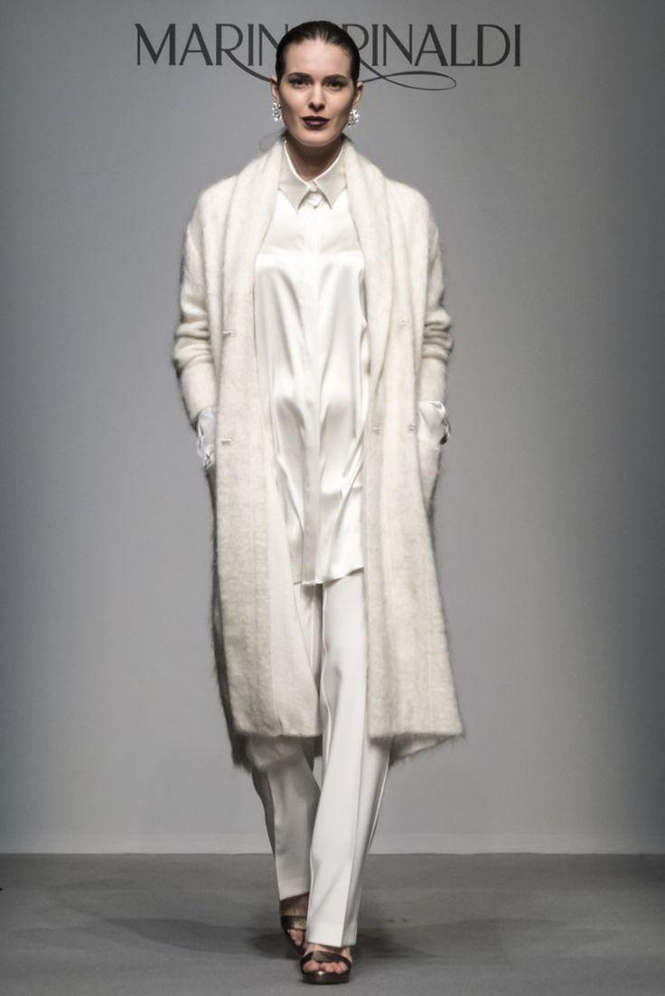 Guarda la sfilata di moda Marina Rinaldi a Milano e scopri la collezione di abiti e accessori per la stagione Collezioni Autunno Inverno 2014-15.