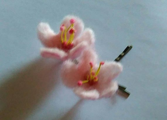 Check out this item in my Etsy shop https://www.etsy.com/uk/listing/506923584/a-pair-of-felted-cherry-blossom-hair