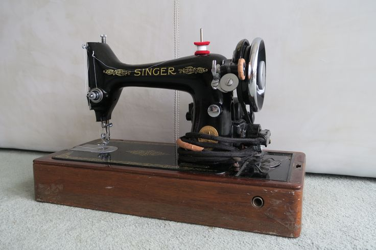 My grandmother's 1950 Singer 99k electric knee-lever 3/4-size domestic sewing machine.
