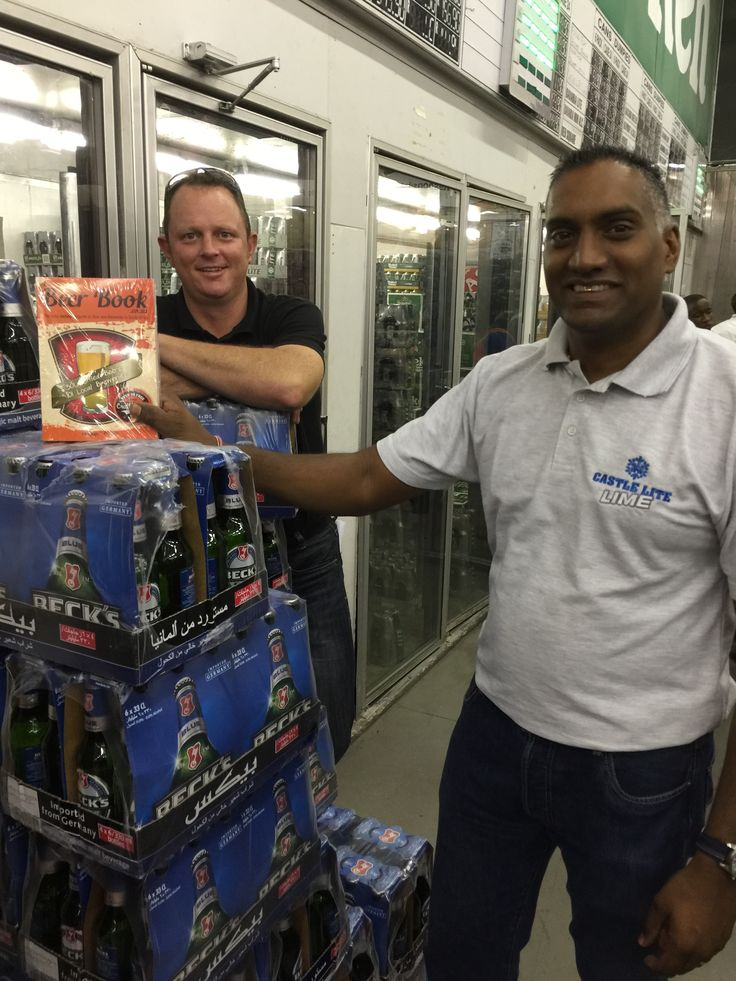 Mervyn Govender,  Liberty Liquors and Mike Wilding, DGB, making sure that Becks made it into The Beer Book
