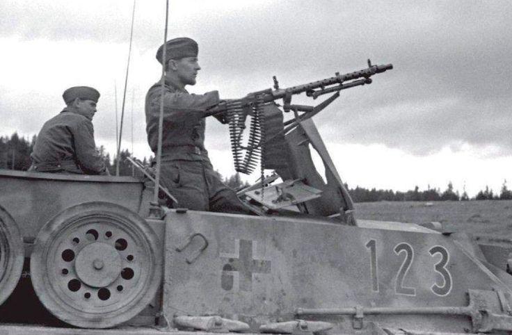A crew member manning a machine gun on the back deck of a StuG 3